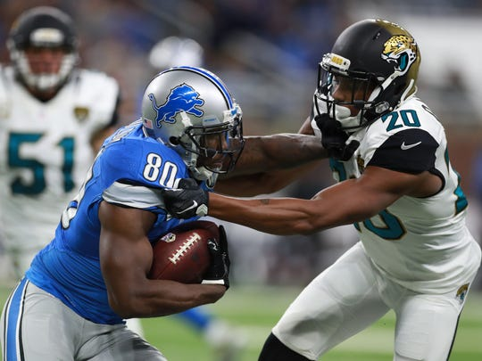 Detroit Lions wide receiver Anquan Boldin (80) pushes off Jacksonville Jaguars cornerback Jalen Ramsey (20) after a catch during an NFL football game Sunday, Nov. 20, 2016 in Detroit.  (Jeff Haynes/AP Images for Panini)