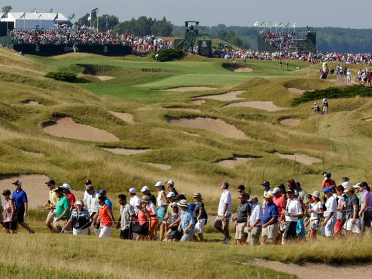 Fans walk to another hole during the PGA Championship Saturday August 15, 2015 at Whistling Straits near Haven.