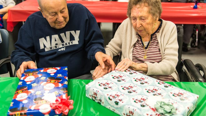 "Veterans open gifts as part of an outrach program by ""Second Wind Dreams"" at Veteran's Memorial Home in Vineland on Wednesday, December 21."
