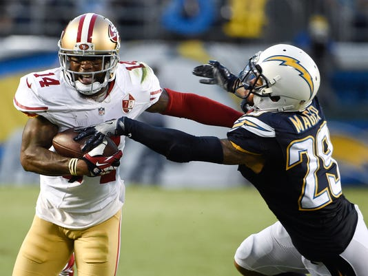 San Francisco 49ers wide receiver Eric Rogers, left, pushes off San Diego Chargers cornerback Craig Mager during the first half of an NFL preseason football game Thursday, Sept. 1, 2016, in San Diego. (AP Photo/Denis Poroy)