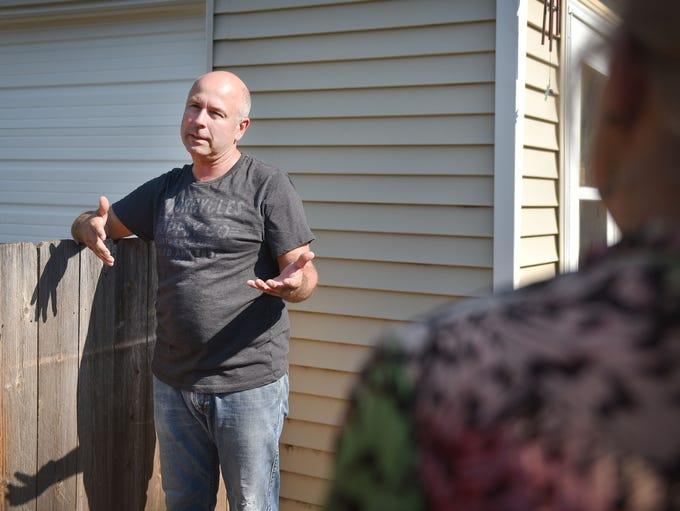 Homeowners John Stammer, left, Sheila Stammer, far