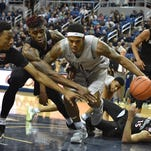 Nevada's Tyron Criswell tries to drive through the SDSU defense during their game Tuesday.