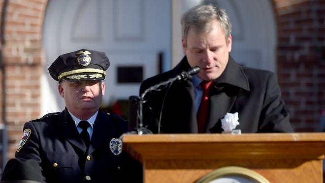 Interim York City Police Chief Troy Bankert stands behind Mayor Michael Helfrich after his appointment was announced on Tuesday.
