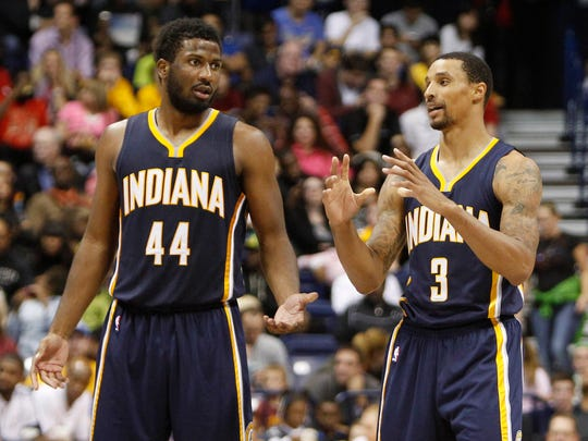 Solomon Hill (44) and George Hill (3) talk at half court against the Cleveland Cavaliers during the second half at the Cintas Center.