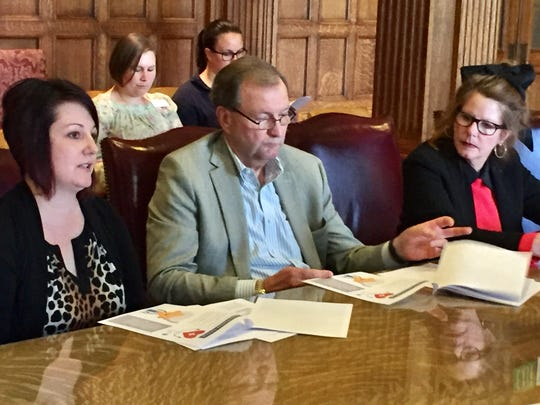 Casey Buckingham of Benefis, left, talks Tuesday to a new state panel while Benefis CEO John Goodnow and Elsie Arntzen, state superintendent of public instruction, look on.