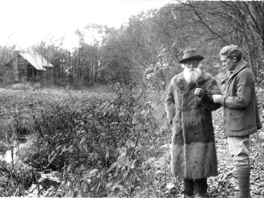 John Burroughs and Clyde Fisher are shown at Slabsides, circa 1919.