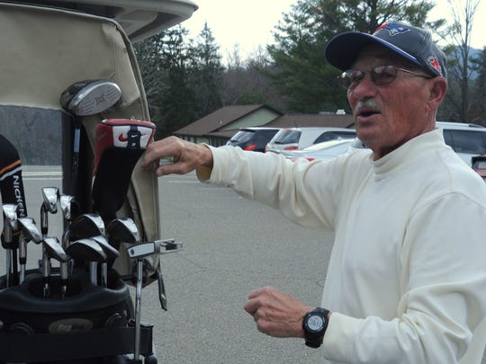 Robert McKinney gets ready to play a round of golf at the Black Mountain Golf Course on March 1.
