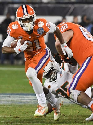 Clemson wide receiver Ray-Ray McCloud (21) runs by teammate guard Maverick Morris (69) blocking for him during the first quarter of the Dr.Pepper ACC football championship in Charlotte on Saturday.