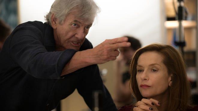 "Director Paul Verhoeven and star Isabelle Huppert filming ""Elle."""