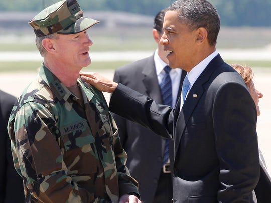 President Barack Obama talks with U.S. Navy Vice Admiral