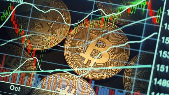 A digital rendering of a bitcoin and a bitcoin price chart.