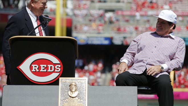 Cincinnati Reds president Bob Castellini and 2016 Reds Hall of Fame inductee Pete Rose share a laugh during pregame ceremonies before the MLB game between the San Diego Padres and Cincinnati Reds, Saturday, June 25, 2016, at Great American Ball Park in Cincinnati.