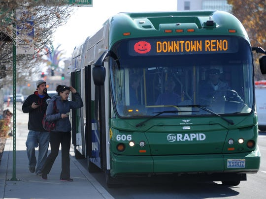 A file photo of passengers getting into an RTC bus in Reno.