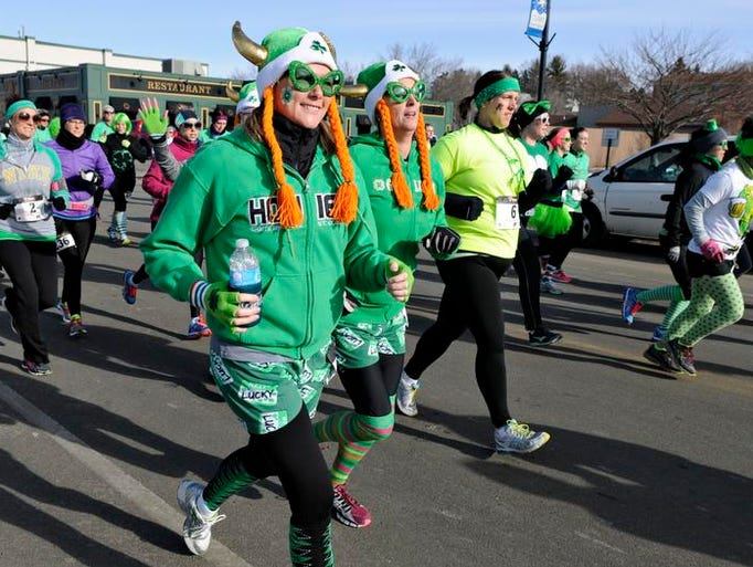 Runners take off at the start of the Shamrock Shuffle 5K and 10-mile run from Jimmy's Pour House in Sauk Rapids Saturday.