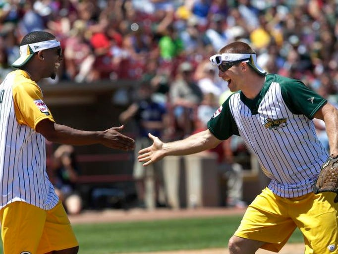Green Bay Packers Casey Hayward, left, and Jordy Nelson have fun during the Jordy Nelson Charity Softball Game Sunday, June 8, 2014, at Neuroscience Group Field at Fox Cities Stadium in Grand Chute, Wisconsin.