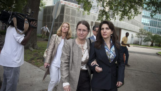 Renee Benson, left, and her daughter Rita leave the New Orleans Civil District Court Monday, June 1 after the first day of Pelicans owner Tom Benson's competency trial. Monday marked the opening of a civil trial in which Benson's disowned daughter, Renee, and her two children, Rita and Ryan LeBlanc, are contesting their ouster from ownership positions with New Orleans' NFL and NBA teams.