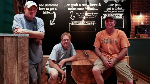 From left to right: Grain Craft Bar + Grill bartender Brian Ford and owners Lee Mikles and Jim O'Donoghue at their new restaurant earlier this week.