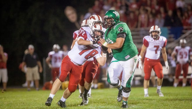 Yorktown's Anthony Todd works off a block against New Palestine in the 2015 season.