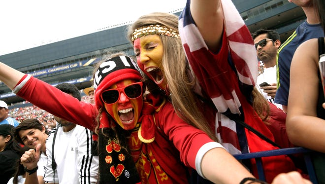 Manchester United fans cheer at Michigan Stadium during the 2014 match against Real Madrid.