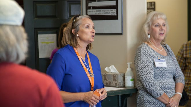 Executive Director Carol Hollowell leads local and state officials on a tour through the Switchpoint Community Resource Center. SwitchPoint marked two years open at its location on 1300 West in St. George on Thursday.