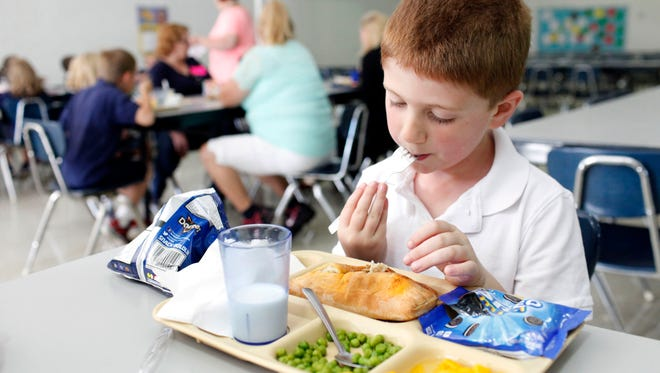 Student Talin Ridge, 8, eats a fresh made empanada during lunch at Ascension. The school recently changed its lunch program to include fresh local chicken, turkey and produce while providing approximately 80 meals a day. Lunch costs $4.00 and includes a salad and milk. Oct. 2, 2017