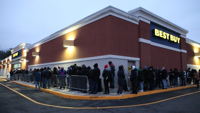 People wait in line at the Best Buy on Central Park Avenue in Hartsdale, New York, Nov. 27, 2014.
