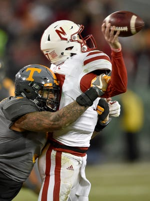 Tennessee Volunteers defensive end Derek Barnett (9) forces an incomplete pass by Nebraska Cornhuskers quarterback Ryker Fyfe (17)  late in the second half of the Franklin American Mortgage Music City Bowl at Nissan Stadium in Nashville, Tenn., Friday, Dec. 30, 2016.