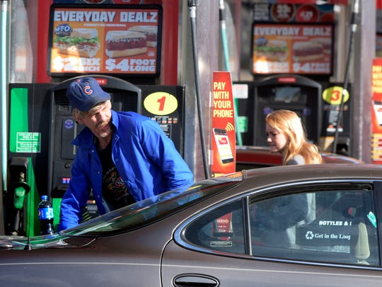 In this file photo, a customers fills up his car at the Sheetz at 1484 Carlisle Ave. Tuesday, Nov. 24, 2015. The Pennsylvania-based chain announced it's spending $15 million to raise employees wages.