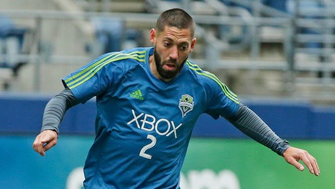 Forward Clint Dempsey practices with the Sounders for their home opener Sunday.