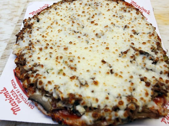 A freshly made pizza from Marion's Pizza  in Mason. (Photo by Tony Tribble)
