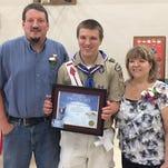 Eagle Scout Michael Schmidt with his parents Craig and Michelle.