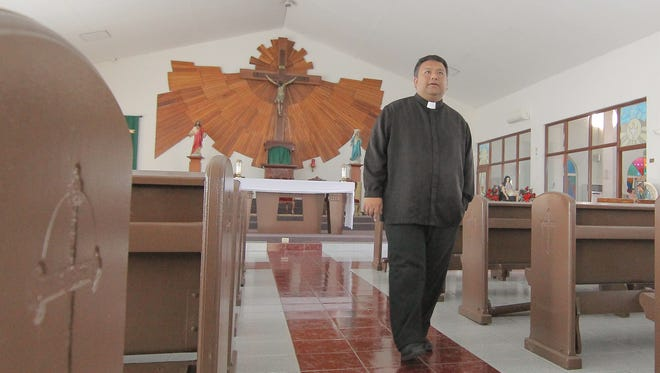 Father Mike Crisostomo, pastor of the Immaculate Heart of Mary Church, is shown in his church in this 2014 file photo. The priest says the church's fiesta this year will emphasize health.