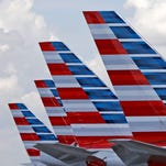 American Airlines planes parked at Miami International Airport.
