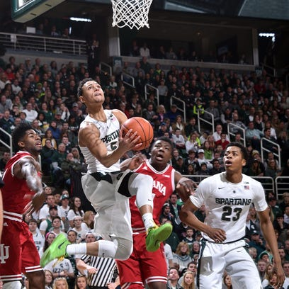 Bryn Forbes drives the baseline under the basket in