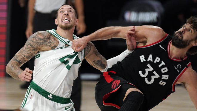 The Celtics' Daniel Theis, left, fights for position for a rebound with the Raptors' Marc Gasol during the second half of Saturday's Eastern Conference semifinal playoff game. Game 5 is Monday night.