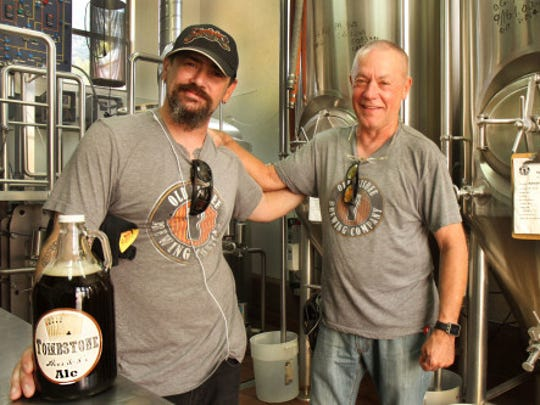 Owner/brewmaster Victor Winquist, right, stands inside
