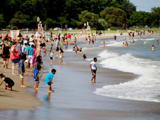 People play in some waves at Bradford Beach in Milwaukee,