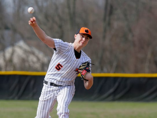 Middletown North's Tyler Ras pitches during the Middletown