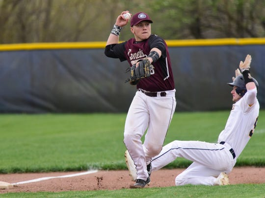 Genoa's Gabe Scott looks to make a throw. The Comets play for a conference crown Wednesday.