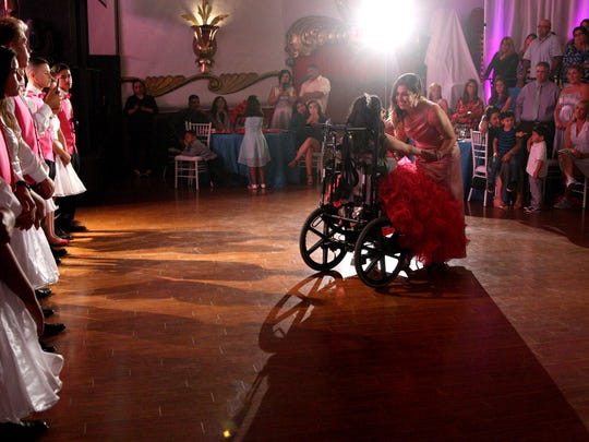 Maribel dances with her daughter Karizma Vargas during her quinceañera celebration.