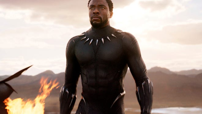 "This image released by Disney and Marvel Studios' shows Chadwick Boseman in a scene from ""Black Panther,"" in theaters Feb. 16, 2018."
