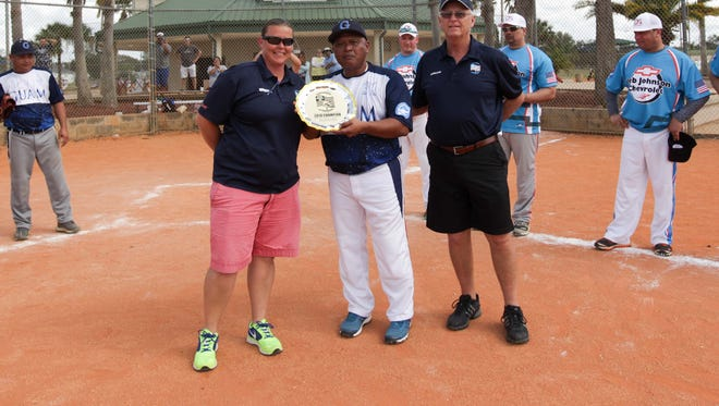 Bud Light Guam Islanders Softball Association 40-plus AAA Masters coach Peter Torres accepts the plaque from Senior Softball USA officials following Guam's win at the Tournament of Champions in Polk County, Fla. on Sunday. Guam beat J.D. Oxford from New York, 2-1 in the championship series.