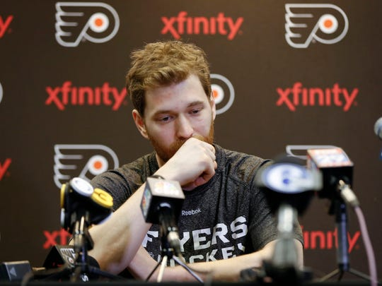 """Philadelphia Flyers' Claude Giroux speaks with members of the media during a news conference Monday, April 11, 2016, in Voorhees, N.J. Ed Snider, the Philadelphia Flyers founder whose """"Broad Street Bullies"""" became the first expansion team to win the Stanley Cup, died Monday, April 11, 2016 after a two-year battle with cancer. He was 83."""