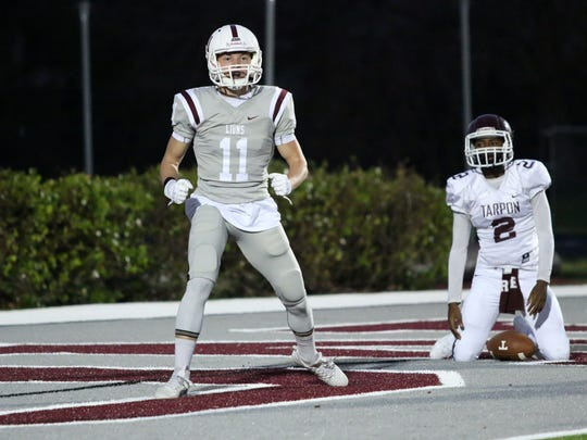 Thomas Casey (11) reacts to a safety during the first quarter of First Baptist Academy's first game back after Hurricane Irma last year against Tarpon Springs.