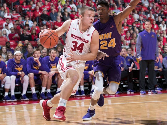 UNI's Isaiah Brown guards Wisconsin's Brad Davison during the Panthers' 69-38 loss Wednesday at the Kohl Center.