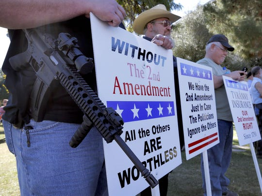 AP Photo/Matt YorkGun rights supporters stand outside the Arizona capitol building in Phoenix during a Guns Across America rally. The nationwide rally was in support of the Second Amendment and called for no new gun laws. Gun rights supporters stand Saturday outside the Capitol in Phoenix during a Guns Across America rally. Matt York/APGun rights supporters stand outside the Capitol Sat, Jan. 19, 2013 in Phoenix during a Guns Across America rally. The nationwide rally was in support of the 2nd Amendment and called for no new gun laws. (AP Photo/Matt York)