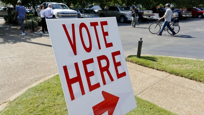 Voters go to the polls at Calvary Baptist Church Tuesday, Oct. 8, 2019.