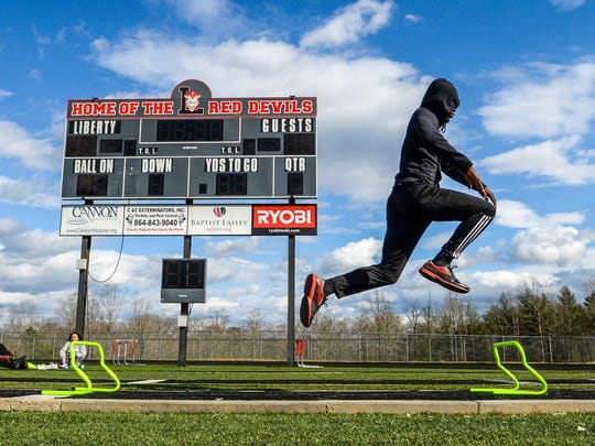 Liberty triple jumper Keyshawn King practices at the high school track on Wednesday.