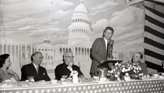 Sen. John F. Kennedy speaks at Jackson Day on Feb. 23, 1957, in Springfield. Pictured with him are U.S. Sen. Stewart Symington, left, J. Howard Hannah, center, and W. Ray Daniel, right, chairman of the Greene County Democratic Party. They were at the Shrine Mosque.