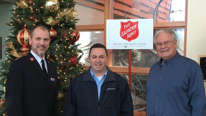 L to R: Ashland Salvation Army Major Brett DeMichael, Kinder Morgan Vice President Allen Fore and United Way of Ashland County representative Tom McGee.